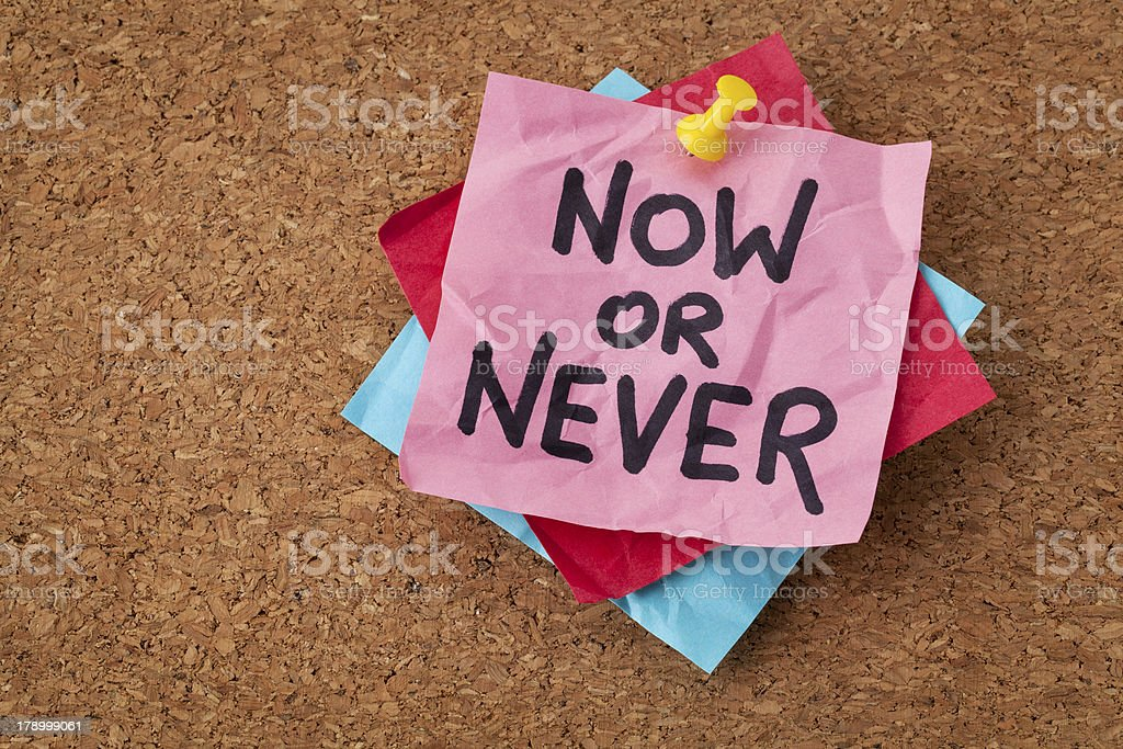 now or never motivational reminder stock photo