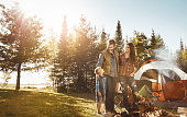Shot of a young family camping in the forest