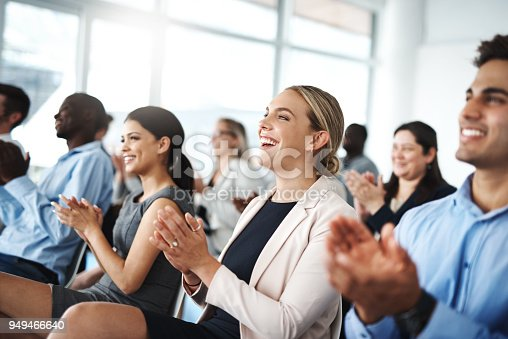 Cropped shot of a group of businesspeople applauding while sitting in a lecture room during a seminar