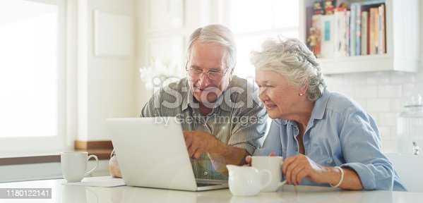 Shot of senior couple using a laptop together at home