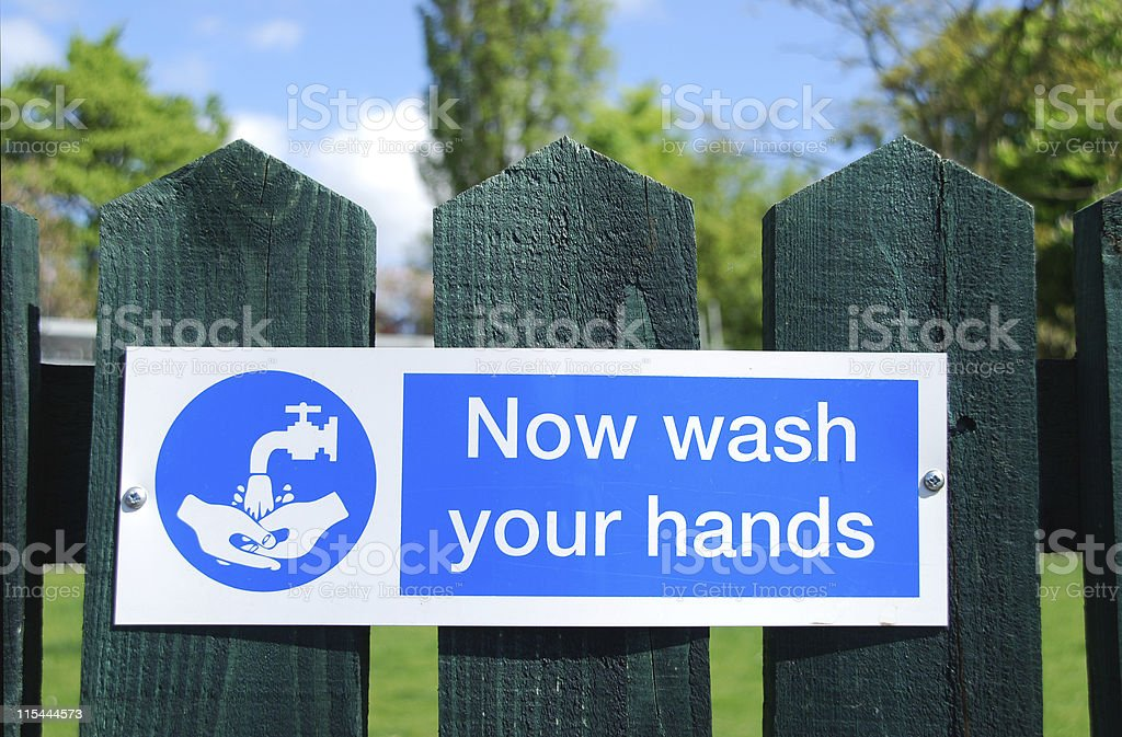 Now wash your hands sign royalty-free stock photo
