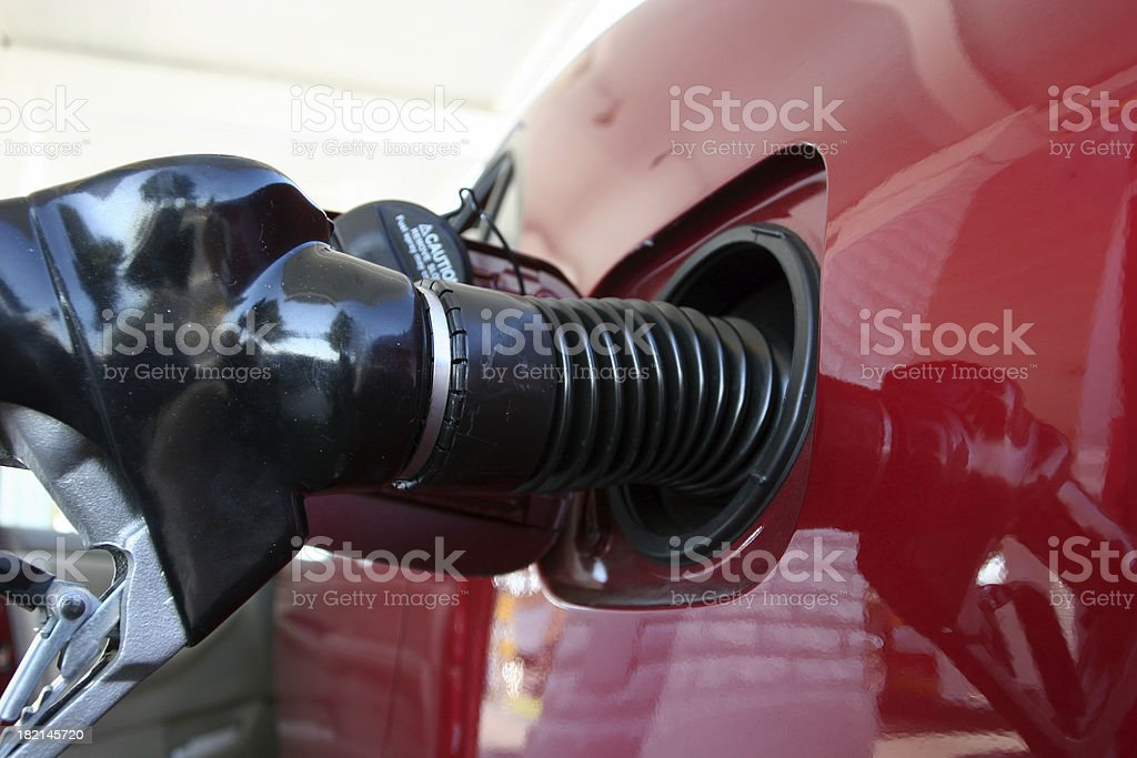 Nozzle and car royalty-free stock photo