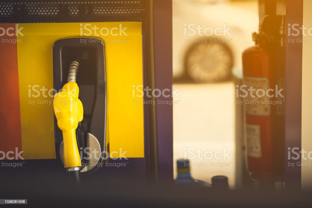 nozzle oil fuel fill on blurred car and fire safety tank stock photo
