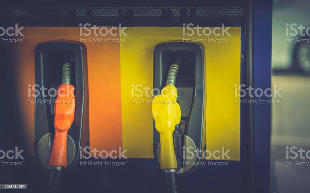 nozzle oil fuel fill on blurred car stock photo