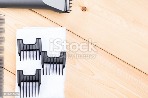1147090180istockphoto nozzles for different lengths of hair on a wooden board 931419976