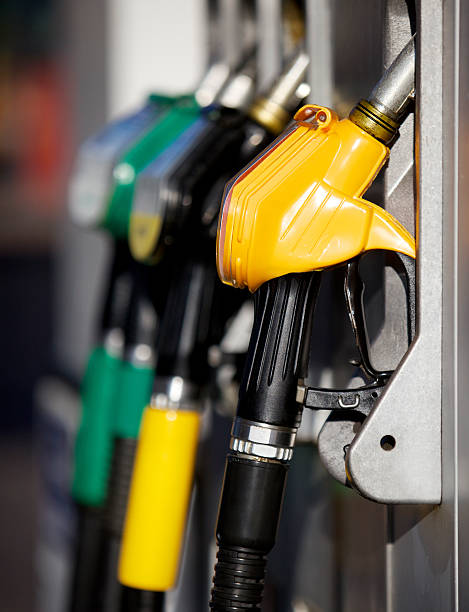 Nozzles in gas station stock photo