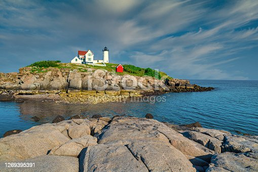 Cape Neddick, Maine, USA 8/02/2019. Nubble Light House at Nubble Point during low tide.
