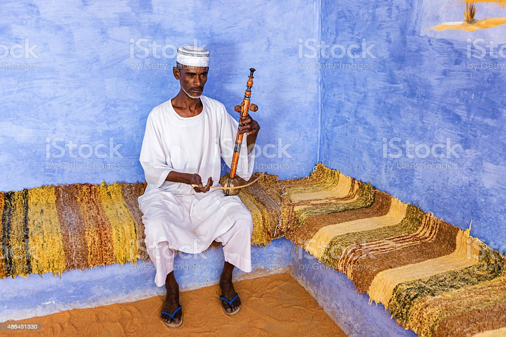Nubian man playing a rebab in Southern Egypt stock photo
