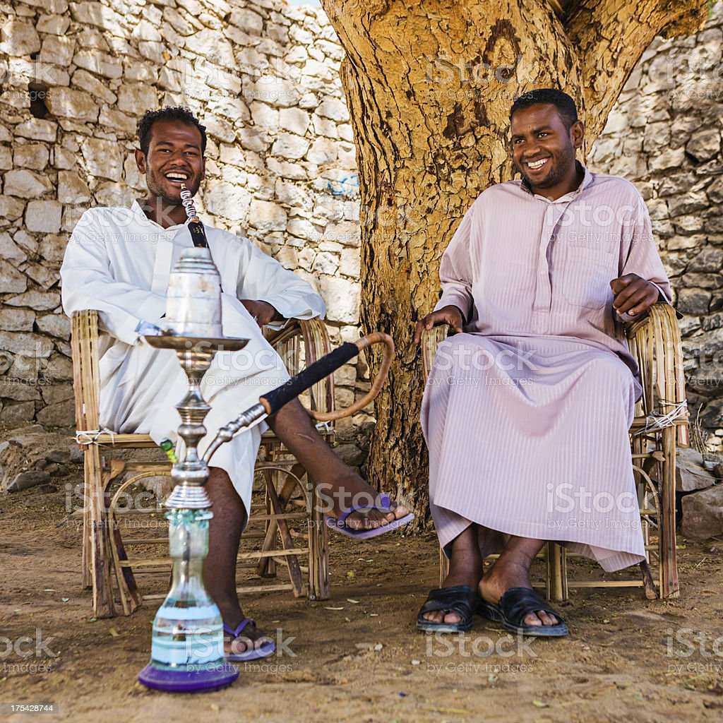 Nubian men smoking waterpipe in Southern Egypt royalty-free stock photo