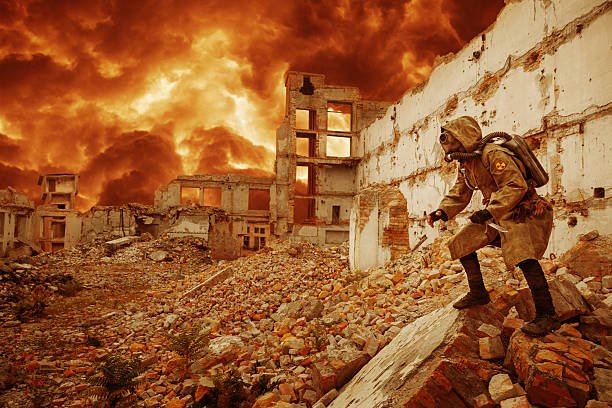 Nuclear apocalypse survivor Post apocalypse. Sole survivor in tatters and gas mask on the ruins of the destroyed city  time zone stock pictures, royalty-free photos & images