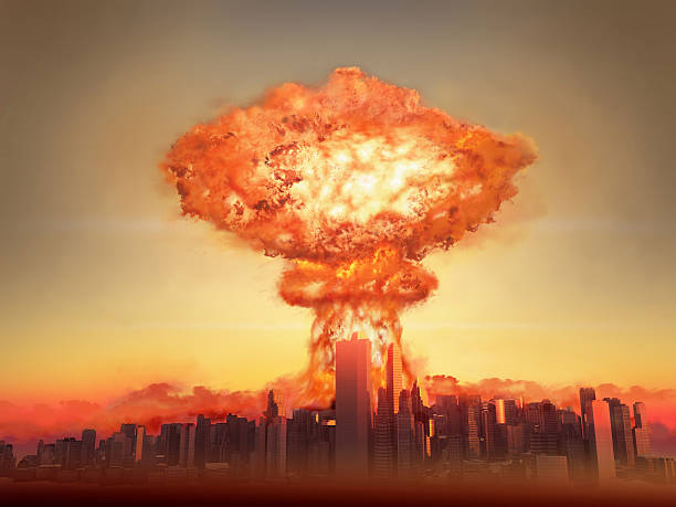 nuclear bomb exploding in a city - nuclear weapon stock photos and pictures