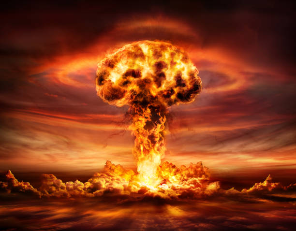 Nuclear Bomb Explosion - Mushroom Cloud Nuclear Explosion With Orange Mushroom Cloud nuclear power station stock pictures, royalty-free photos & images
