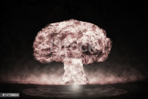 istock Nuclear explosion in an outdoor setting. Symbol of environmental 614739604