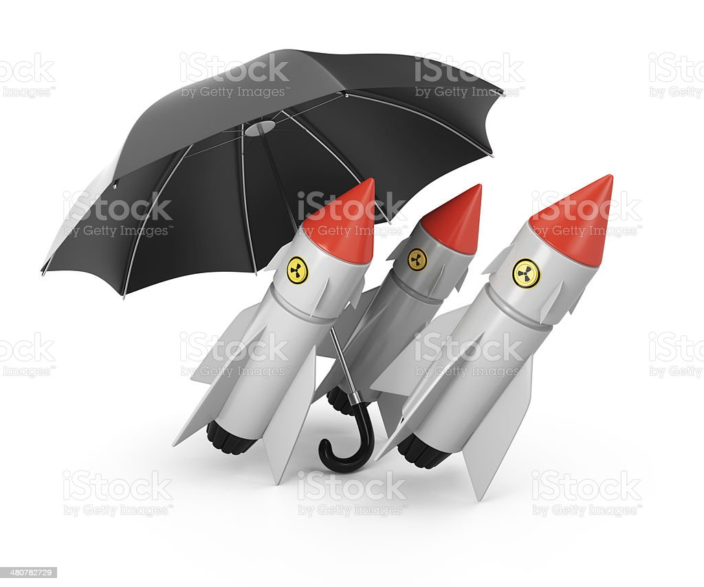 Nuclear missiles under umbrella royalty-free stock photo