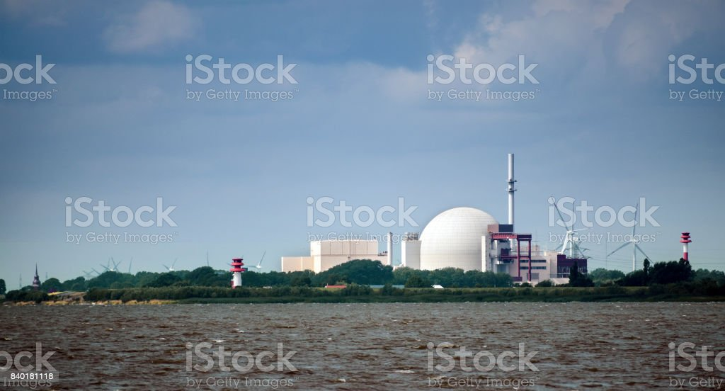 Nuclear power plant at Brockdorf, Schleswig-Holstein in northern Germany, view from the river Elbe, copy space stock photo