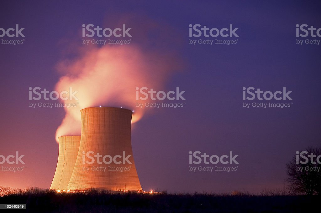 Nuclear Power Plant Cooling Towers at Dusk stock photo