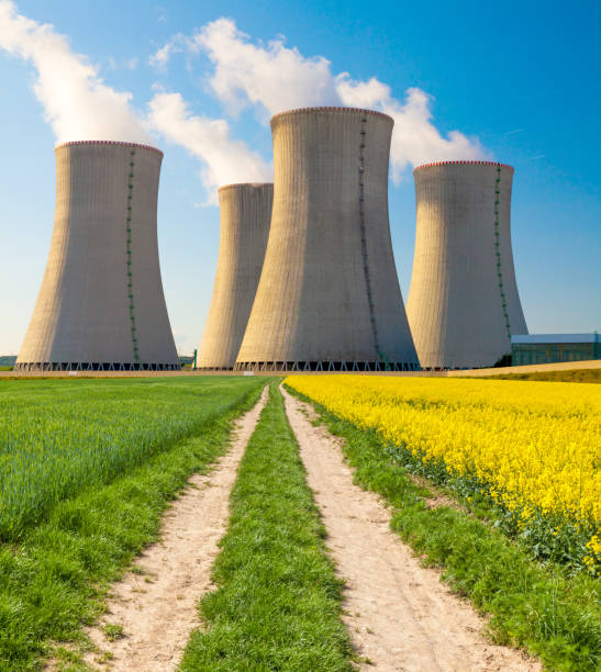 Nuclear power plant Dukovany with rape field, Czech Republic stock photo