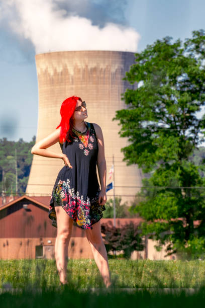 Nuclear Power Plant Lifestyle A beautiful 19 year old female standing in front of a nuclear power plant. sdominick stock pictures, royalty-free photos & images