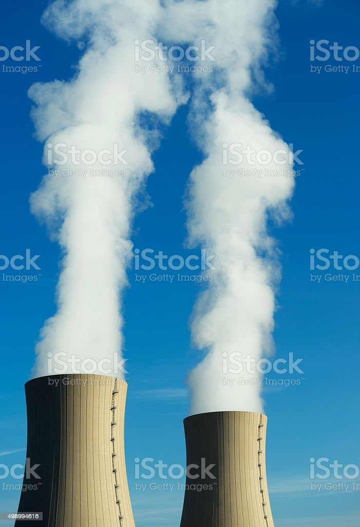 Nuclear power plant on a sky background in sunlight stock photo