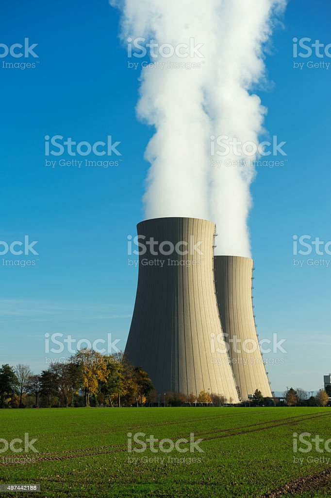 Nuclear power plant on the sky background in sunlight stock photo