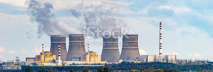istock Nuclear power plant panorama with two RBMK type reactors, same as Chernobyl type, and cooling towers in high resolution. Legacy real nuclear operating power plant photo. 1226013219