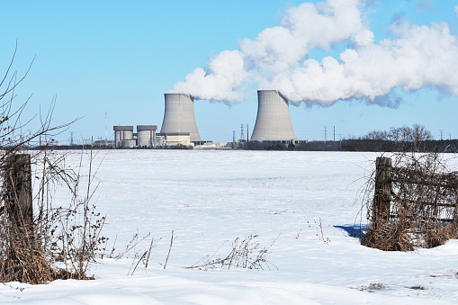 Nuclear plant and cooling towers in the distance.