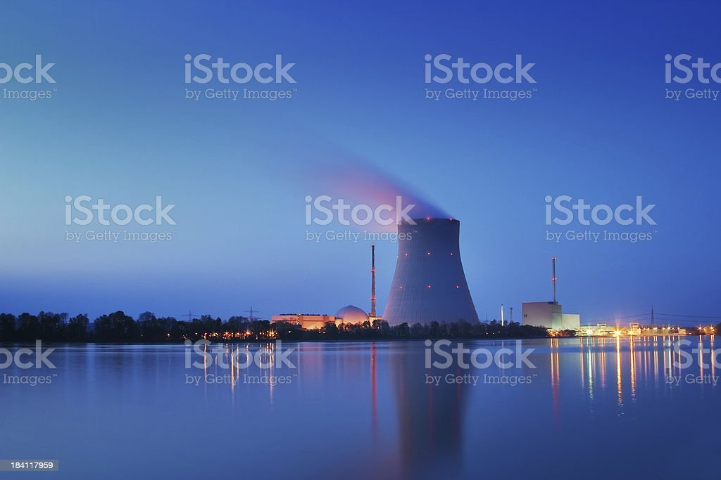 Nuclear Power Plant Long shutter time shot of a nuclear power plant at night. Image created using dri techniques. Blue Stock Photo
