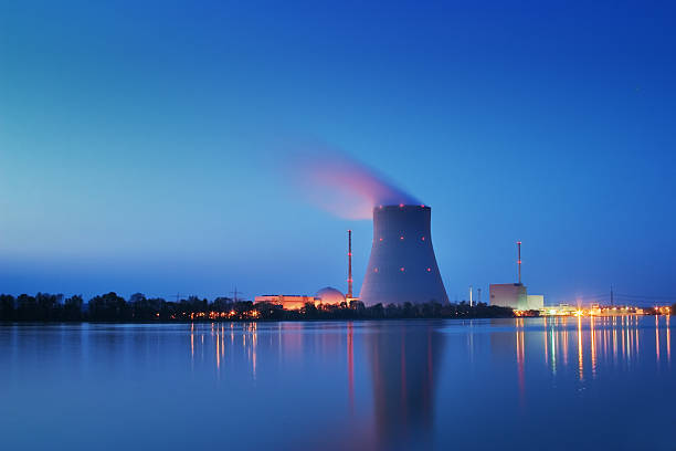 Nuclear Power Plant Long shutter time shot of a nuclear power plant at night. Image created using dri techniques. nuclear power station stock pictures, royalty-free photos & images