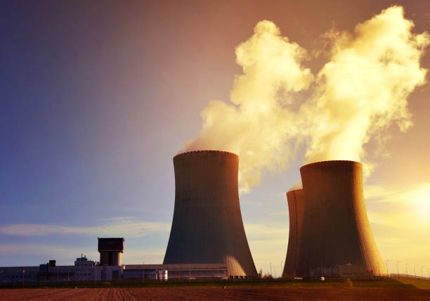 nuclear power plant temelin at sunrise. - nuclear power station stock photos and pictures