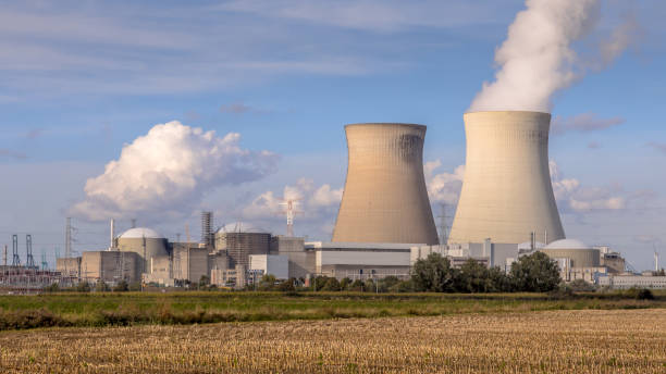 Nuclear power plant with cooling towers stock photo