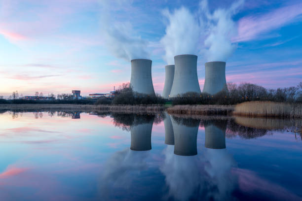 Nuclear power plant with dusk landscape. Nuclear power plant after sunset. Dusk landscape with big chimneys. nuclear power station stock pictures, royalty-free photos & images