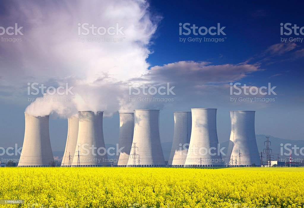 Nuclear Power plant with yellow field and blue sky stock photo