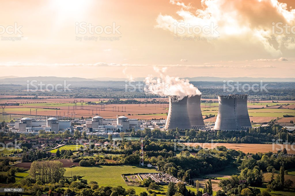 Nuclear power station aerial view in countryside landscape during sunset