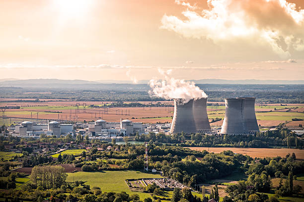 Nuclear power station aerial view in countryside landscape during sunset stock photo
