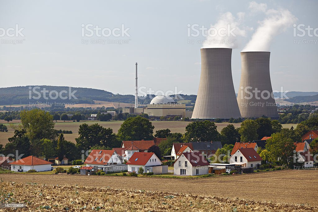Nuclear Power Station Behind Living Houses stock photo