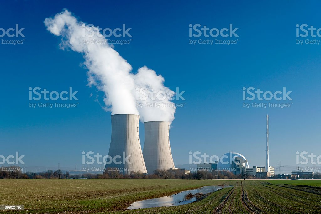 Nuclear power station Grohnde with steaming cooling towers royalty-free stock photo