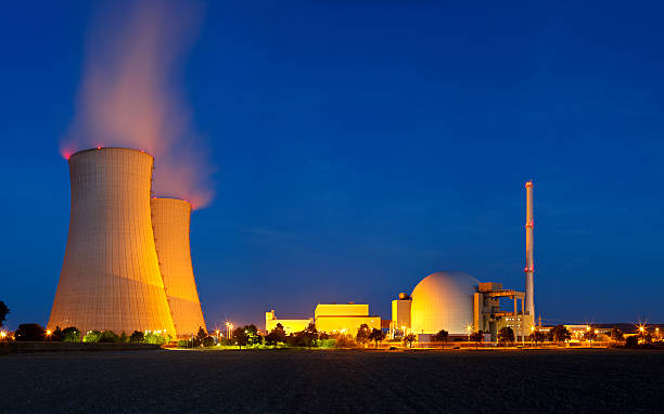 Nuclear Power Station With Night Blue Sky  nuclear power station stock pictures, royalty-free photos & images