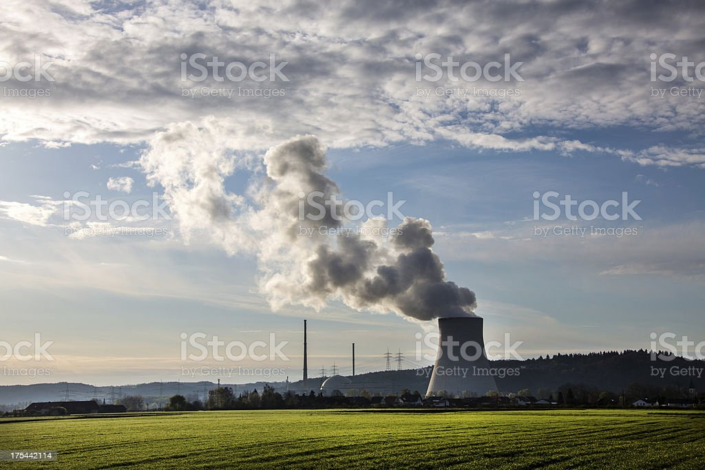Nuclear Power station with steaming cooling tower stock photo