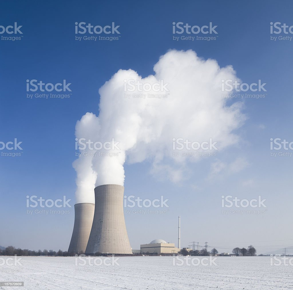 Nuclear power station with steaming cooling towers countryside in winter royalty-free stock photo