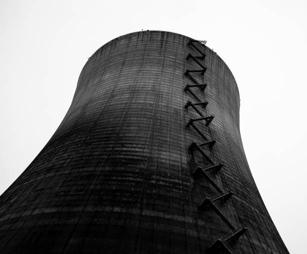 Nuclear reactor cooling tower taken in black and white stock photo