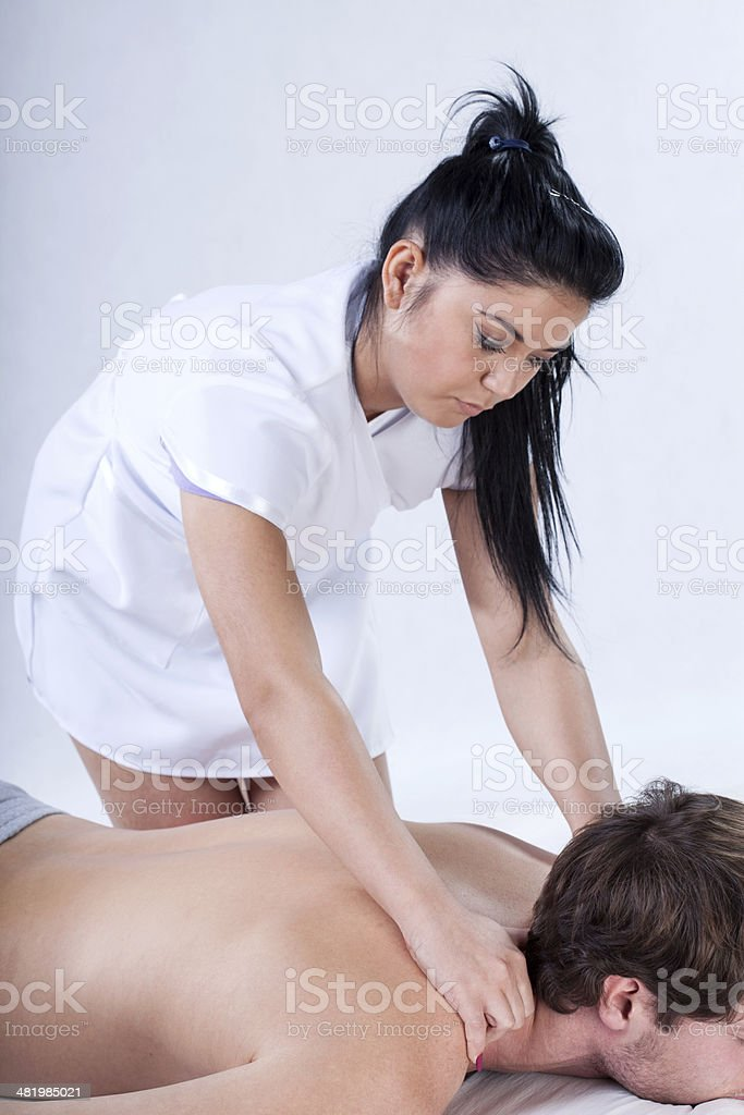 Nude back massage stock photo