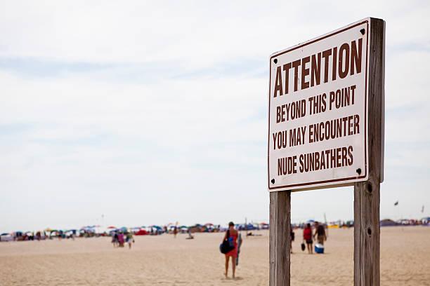 nude beach warnung - fkk strand stock-fotos und bilder