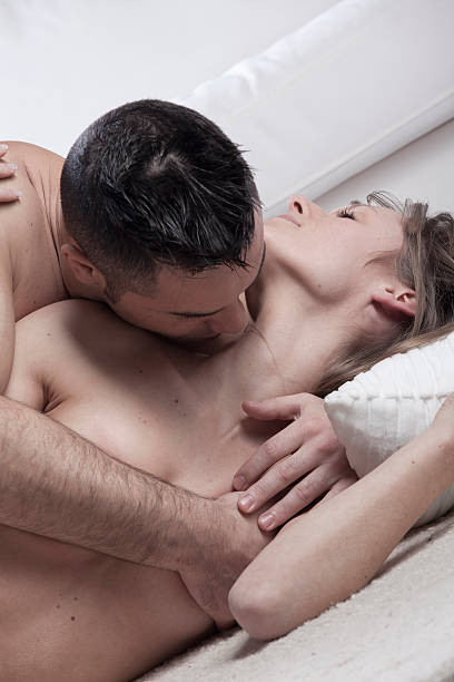 nude couple kissing on floor - kissing on neck stock photos and pictures