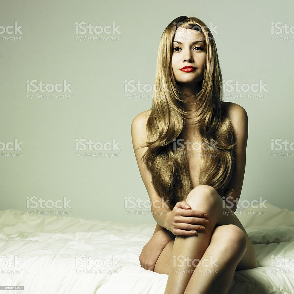 Nude elegant woman in bed royalty-free stock photo