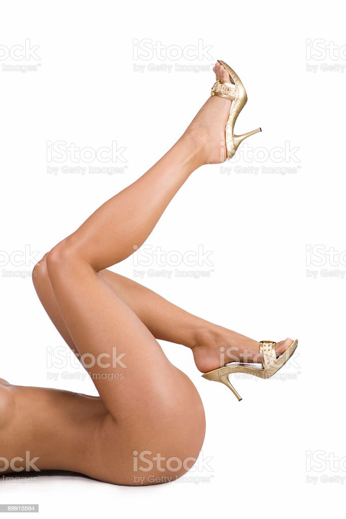 Nude legs in gold shoes royalty free stockfoto