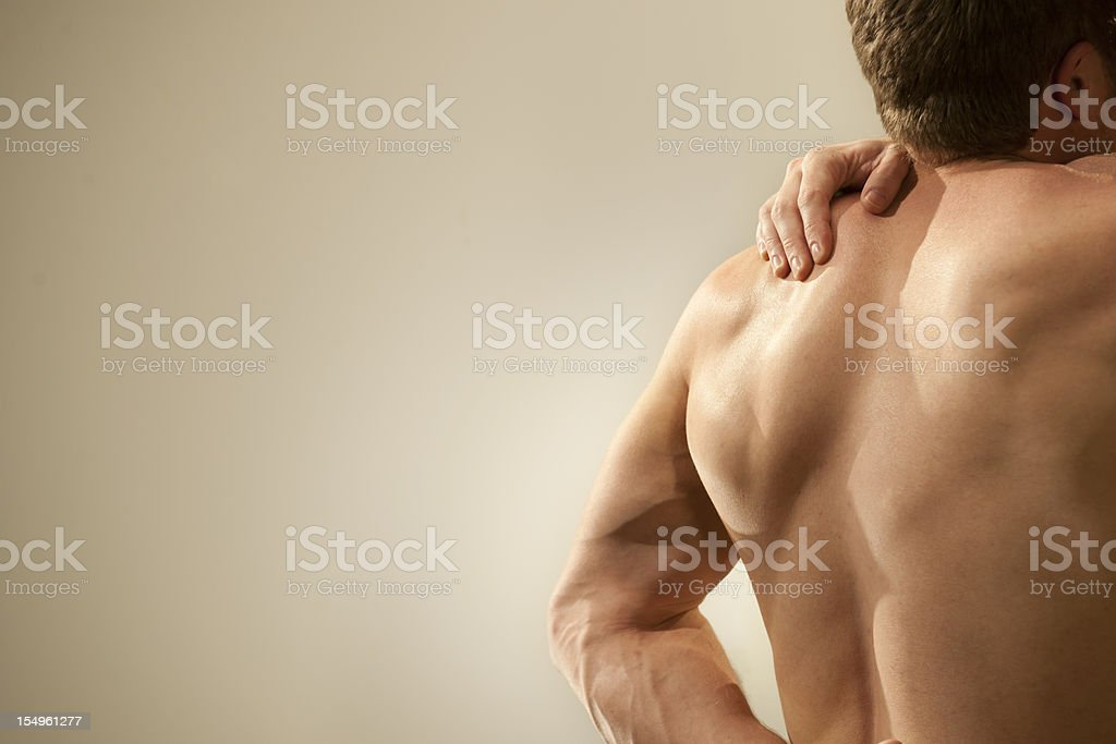 nude man with shoulder pain stock photo