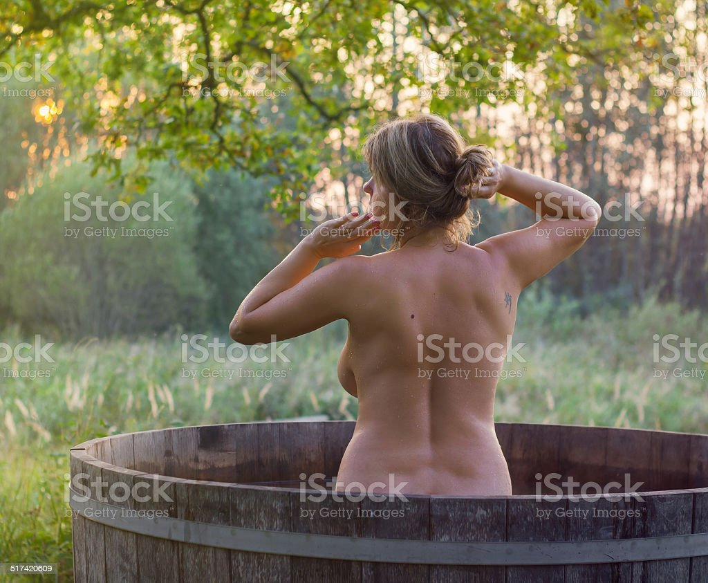 Nude in a hot tub