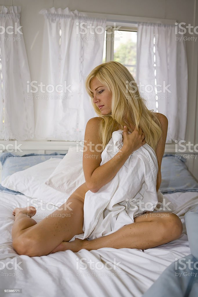 Nude Woman sitting in Bed royalty-free stock photo