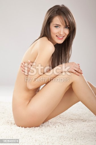 Nude Woman Sitting On Floor Stock Photo  More Pictures Of -5547