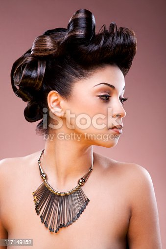istock Nude women wearing a necklace and hair tied up 117149152